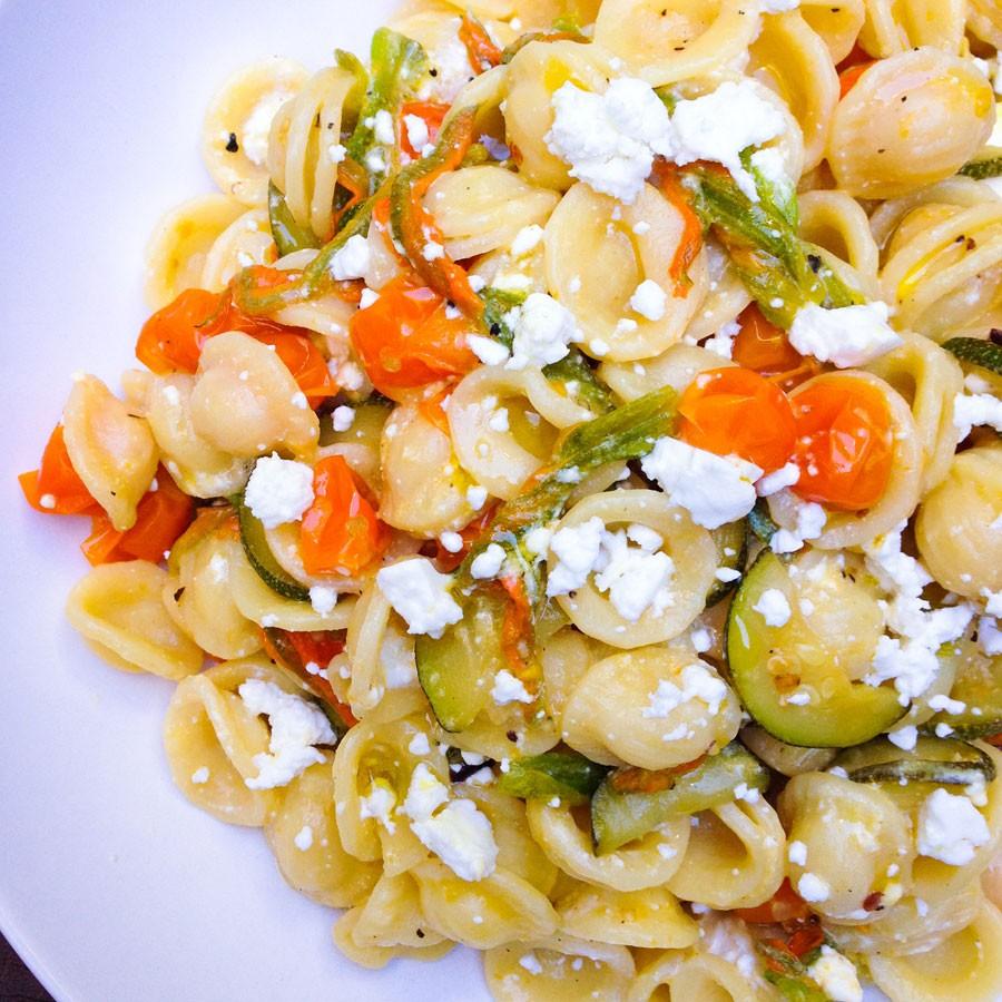 Orecchiette with Zucchini Blossoms, Baby Tomatoes and Feta